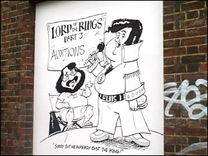 giant cartoon of Peter Jackson and Elvis
