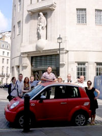 The Electric Ride team with their Think City Electric car outside Broadcasting House.