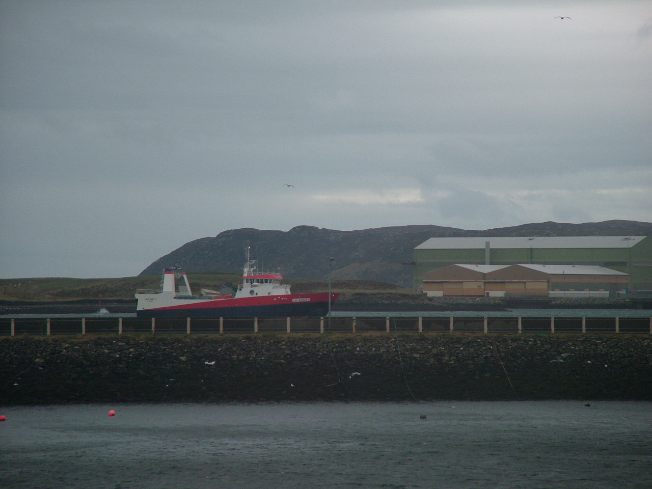 Jack Abri (Lorient) entering Stornoway Harbour; Arnish Yard in background