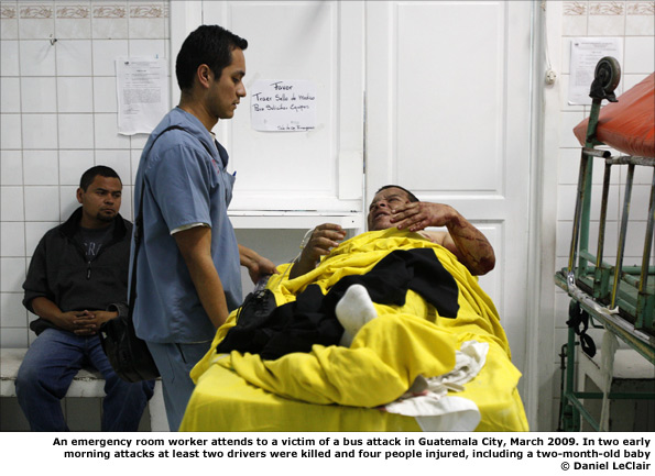 An emergency room worker attends to a victim of a bus attack in Guatemala City