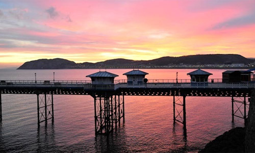 Sunset over Llandudno pier by Mike Pritchard.
