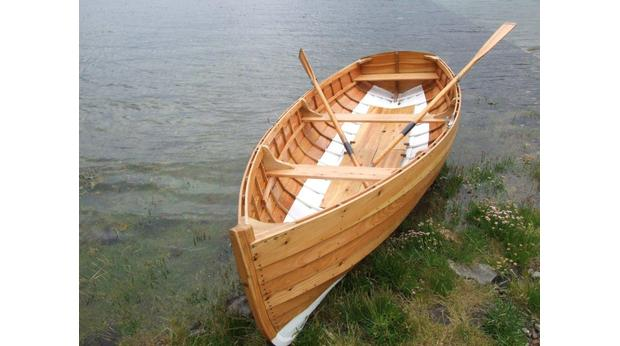 Traditional clinker built wooden dinghy