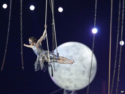 A performer suspended in midair during the opening ceremony for the Paralympics 2012