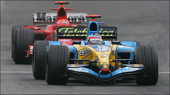 Renault's Fernando Alonso holds off Michael Schumacher's Ferrari in the closing laps to win the 2005 San Marino Grand Prix