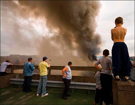 People watch the smoke