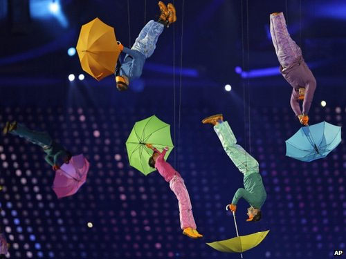 Performers with umbrellas are suspended in the air during the opening ceremony for the Paralympics 2012