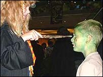Picture: Girl dressed as Hermione with a boy dressed as an alien
