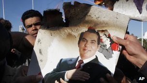 Protesters in Tunis burn a photo of former President Zine al-Abidine Ben Ali