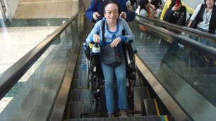 A delighted Liz finally gets her ride on the wheelchair accessible escalator in Tokyo