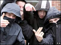 Teenagers wearing hoods