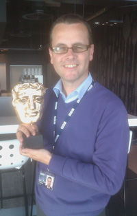 Frank Keogh, BBC sports journalist, with a BAFTA won by his department