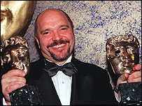 Anthony Minghella with a pair of Baftas