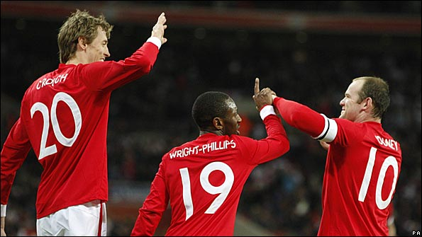 Crouch celebrates with Shaun Wright-Philips and Wayne Rooney