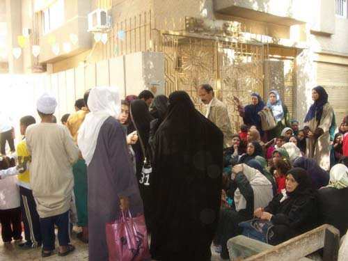 Crowd of people waiting for the Qurbani meat