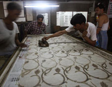 Man in process of block printing