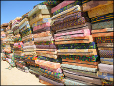 Stacks of mattresses provided for artists and members of the press to drag into their bedouin accommodation at the festival