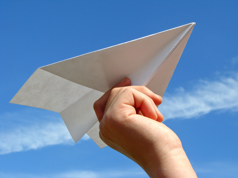 child's hand with paper plane @ D Leonis - fotolia
