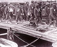 Allied wounded are on their way to the ships that will evacuate them from the Gallipoli peninsula