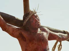Jesus hanging from his cross, dead or dying