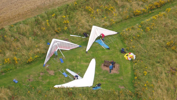 Aerial shot of hang-gliders on ground