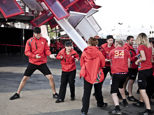 Coca Cola employees in group dance