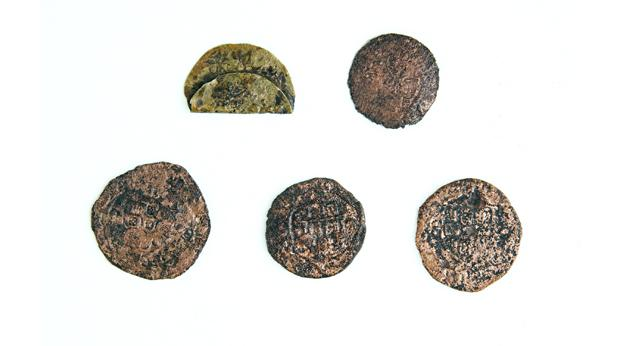 Four Portuguese coins, along with a jetton, found during the excavation in 2002. ©Newport Museum and Heritage Service