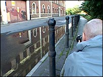 Simon Brown lines up a photograph