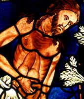 Stained glass window of Adam working in the Garden of Eden