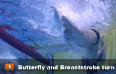 Swimmer performing a breaststroke turn