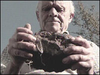 Farmer Dudley Coombe holding a stone