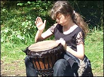 Girl playing a drum