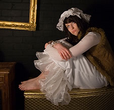 Teenager sitting, dressed in period clothing