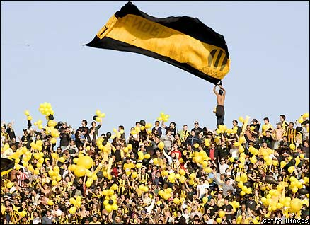 Penarol fans attend their team's match against Nacional