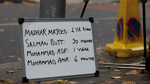 A board outside Southwark Crown Court lists the Pakistan players' sentences