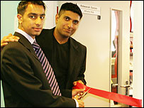 Wajid Khan and Zahoor Hussain cut the ribbon to officially open the Centre for Volunteering and Community Action.