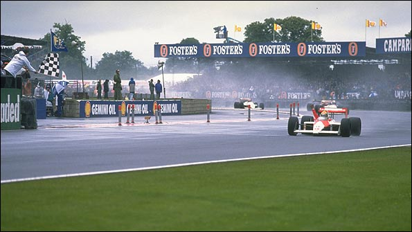 Ayrton Senna takes the chequered flag for McLaren at the 1988 British Grand Prix