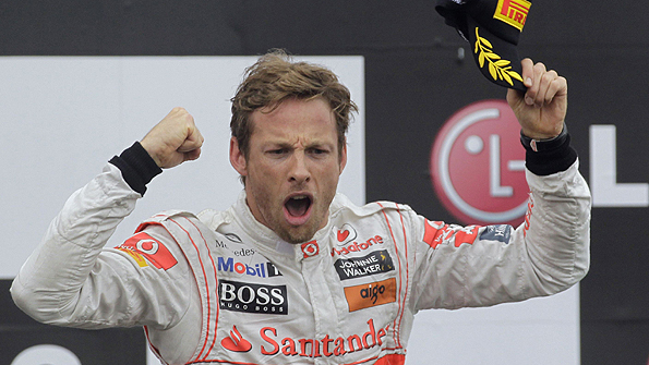 Jenson Button celebrates his maiden Formula 1 victory after winning the 2006 Hungarian Grand Prix for Honda