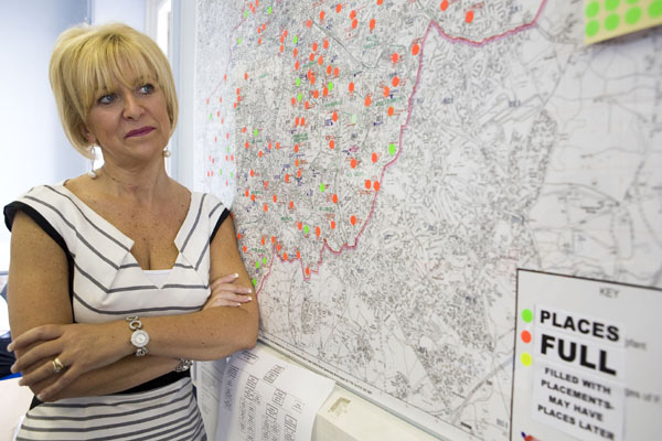 Head of admissions and appeals at Birmingham City Council Julie Newbold stands by a map of her area
