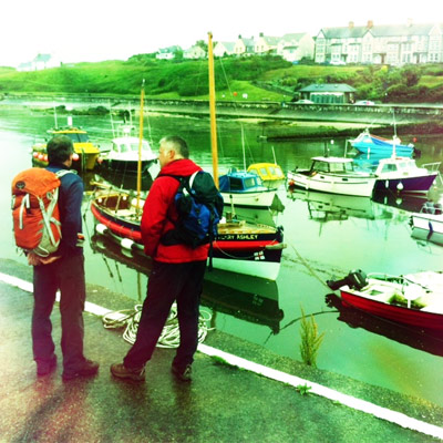 Producer Gareth Rees-Rowlands and Derek looking at the restored lifeboat in the harbour.
