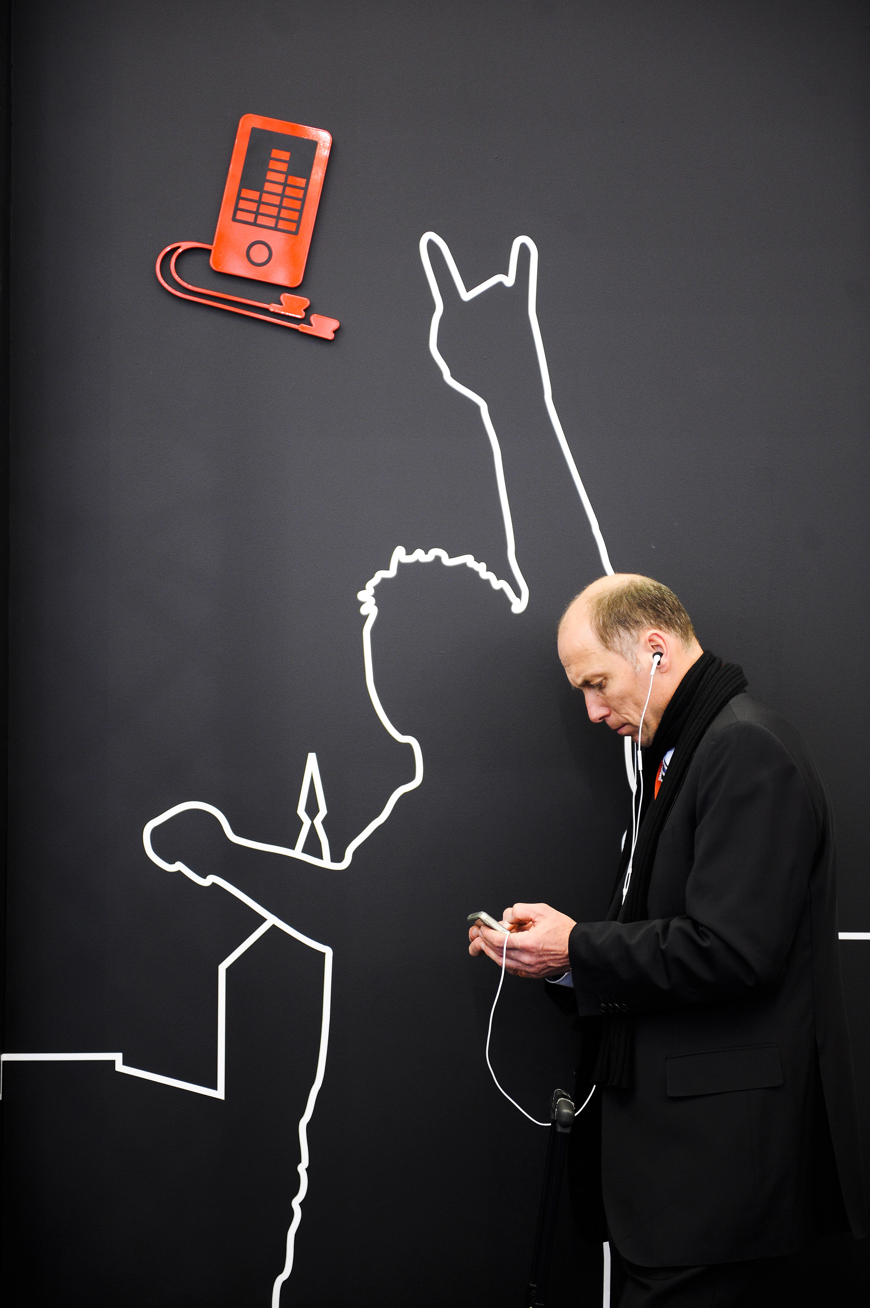 A visitor checks his mobile phone as he attends the 1st day of Mobile World Congress on February 14, 2011 in Barcelona, Spain. The Mobile World Congress hosts some of the world