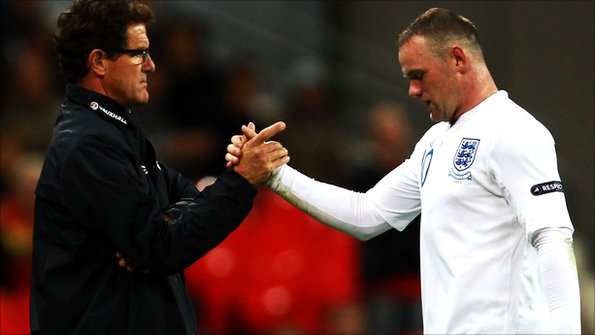 Fabio Capello shakes hands with Wayne Rooney