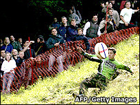 Competitor chasing the cheese on Cooper's Hill in 2006 (Photo: Carl De Souza, AFP Getty image)