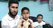 A father and his sons, one of whom needs urgent medical treatment