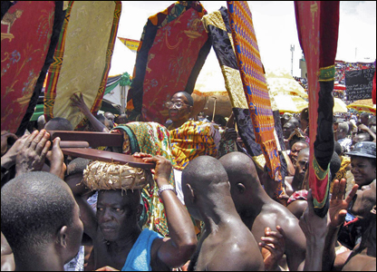 The Ashanti queen mother is carried by her followers to celebrate a decade of rule by her son Otumfuo Osei Tutu II.