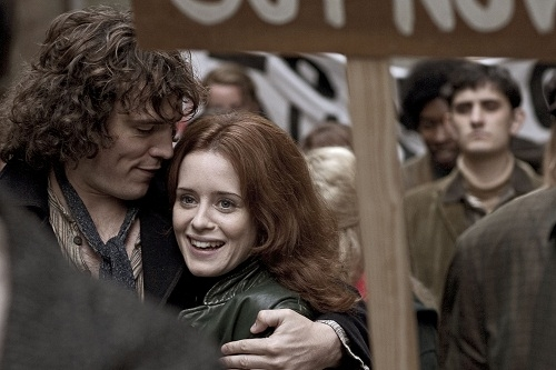 Jack (Sam Claflin) puts his arm round Charlotte (Claire Foy) at a demonstration