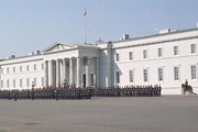 The academy at Sandhurst, a classical white building with troops parading outside