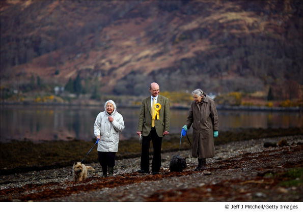 Alan Reid, the Liberal Democrat candidate for Argyll and Bute, meets constituents as he walks beside Loch Etive