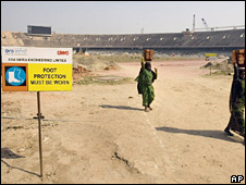 Workers at a Commonwealth Games site in Delhi