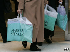 Woman carrying M&S bags