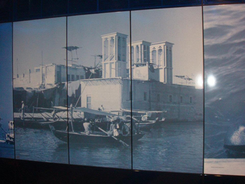 Picture showing the wind towers and boats of old Dubai